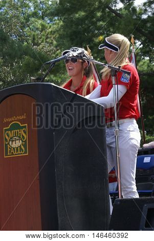 SMITHS FALLS ON CANADA SEPTEMBER 09 2016 - A 50 Editorial Image Series of Pro Golf Sensations Brooke M. Henderson and her sister Brittany Henderson giving a speech in front of their Hometown of Smiths Falls shortly after the efforts in the Summer Rio Olym