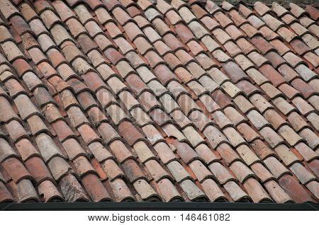 Old roof with shingles in a small city in italy