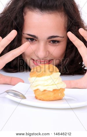 Young girl eating a yumy cake