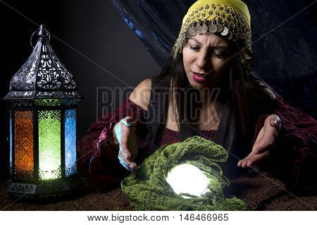 Fortune teller looking upset or confused because of the bad news she is predicting