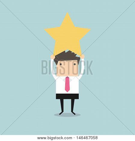 Businessman reaching up to get a golden star trophy
