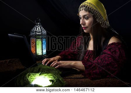 Fortune Teller blogging about her predictions with a computer online