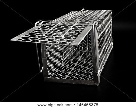 A New Cage mouse trap on black background