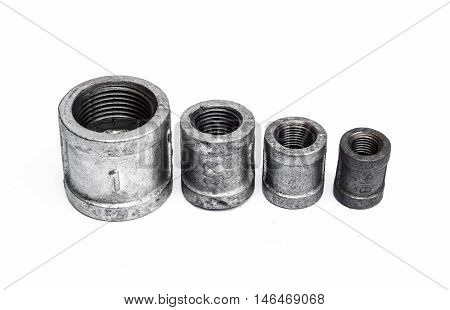 The Various metal fittings inner for pipes on white