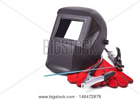 Welding equipment isolated on a white background, welding mask, leather gloves, welding electrodes, high-voltage wires with clips, set of accessories for arc welding