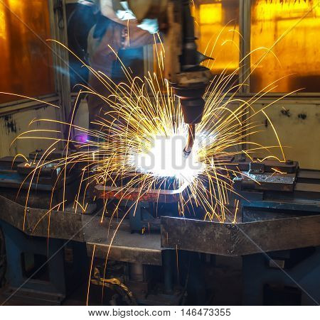 Welding robots in manufacturing automobile parts factory.