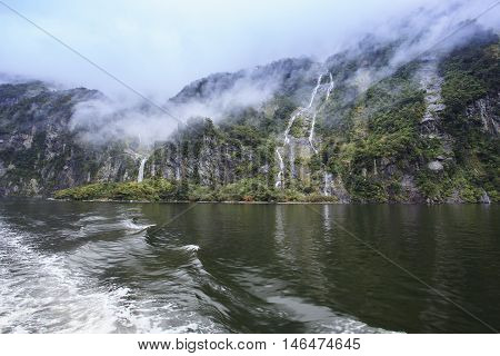 water falls in milford sound fiordland national park new zealand important natural traveling destination