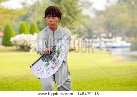BANGKOK THAILAND - FEBRUARY 20 2016: Unidentified group of people practice Tai Chi Chuan in a park
