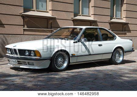 TURKU, FINLAND - JUNE 13, 2015: Retro car sports coupe BMW E24 white on city street. Tourist landmark