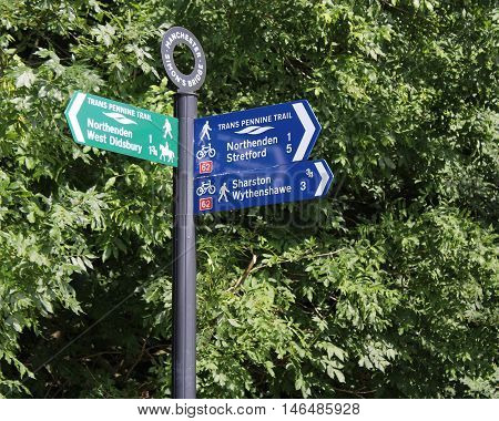 MANCHESTER, ENGLAND, AUGUST 24 2016: A sign post for the Trans Pennine Trail, a 215 miles long route for walkers and cyclists linking the North and Irish seas, through the Pennines in northern England.