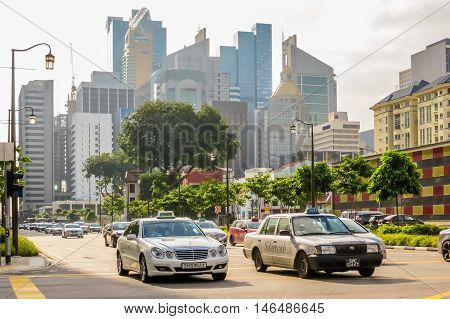 SINGAPORE, REPUBLIC OF SINGAPORE - JANUARY 09, 2014: Street view of Chinatown, Singapore city. Road traffic, old colonial and modern buildings