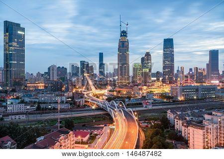 modern urban scene of tianjin in nightfall China