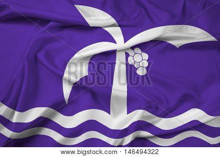 Waving Flag of Macae Brazil, with beautiful satin background