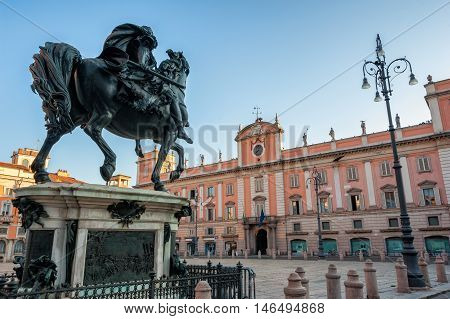 The big bronze equestrian statue in front of the Palazzo del Governatore Piacenza Italy