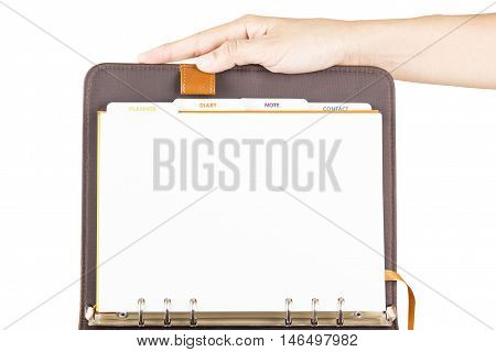 diary brown leather open page white paper and grip by hand.