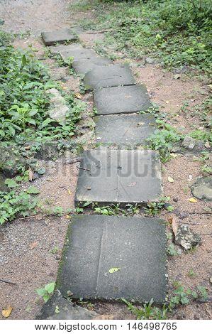 close up cement block walkway in nature garden