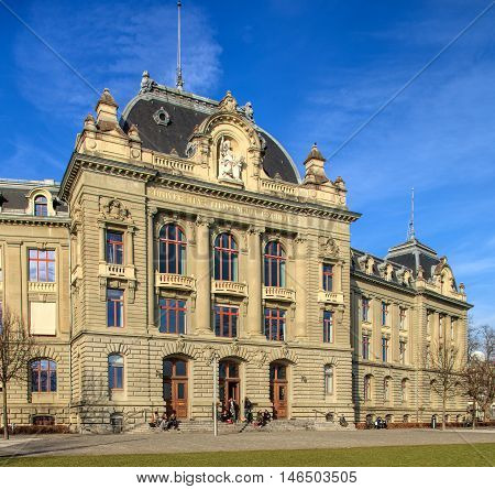 Bern, Switzerland - 29 December, 2015: the University of Bern building people at the entrance to it. The University of Bern is a university in the city of Bern, founded in 1834, regulated and financed by the Swiss Canton of Bern.