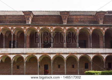 MILAN, ITALY - APRIL 14 2015: Frontal view of the facade of the Lavatory Cloister at Historic State Univeristy of Milan Italy