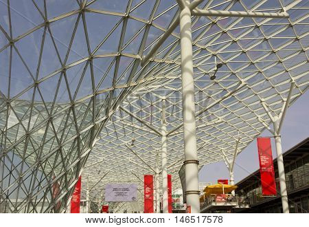 MILAN, ITALY - APRIL 15 2015: Architectural view of the covered glass roof of Fiera Milano during Salone del Mobile fair in Milan