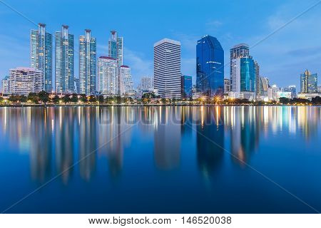 Twilight city office tower with full water reflections, Bangkok Thailand
