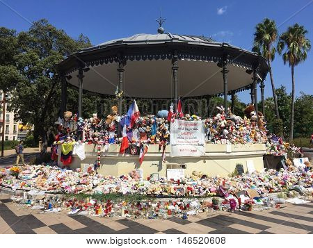 NICE - SEPTEMBER 9: Flowers and notes laid at a bandstand in Jardin Albert 1 as a memorial to those lost close by in the Bastille Day attack earlier in the year on September 9, 2016 in Nice, France.
