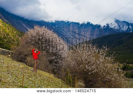 Portrait Young Pretty Girl Wearing Red Jacket Himalays Mountains.Asia Nature Morning Volcano Viewpoint.Mountain Trekking, View Landscape.Woman Happy Smiling.Horizontal picture. Hikking Sport Activity