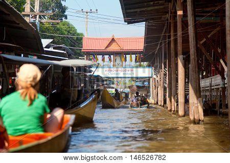 Damnoen Saduak Thailand - March 21 2011 - People selling goods from their boats at Damnoen Saduak Floating Market