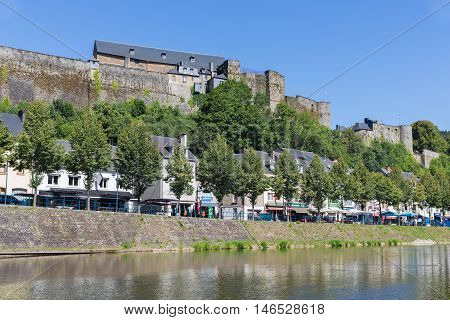 BOUILLON BELGIUM - AUG 13: Belgian medieval city along river Semois with promenade and castle on August 13 2016 in Bouillon Belgium