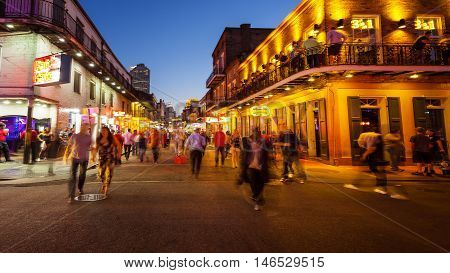 NEW ORLEANS, LOUISIANA - MAY 5th: View of unidentified people on Bourbon Street at night in the historic French Quarter of New Orleans, Louisiana on May 5th, 2016.