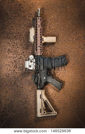assault rifle on the rusty steel plate