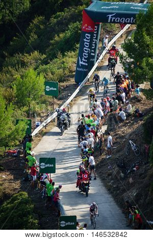 CASTELLON - SEPTEMBER 7: Mathias Frank leads the grupo in the last km of Mas de la Costa mountain stage of la vuelta on September 7, 2016 in Castellon, Spain