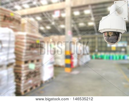 CCTV system security in warehouse of factory chemical blur background.