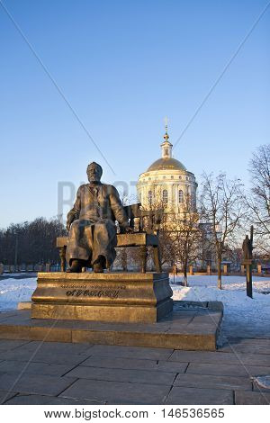 Historic centre of the city of Oryol. Russia. Monument to great Russian writer Leskov and orthodox church.