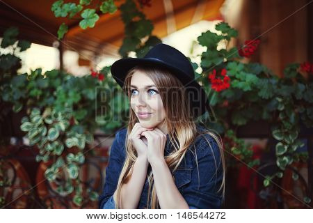 Young beautiful woman wistfully looking up. Colorful background.