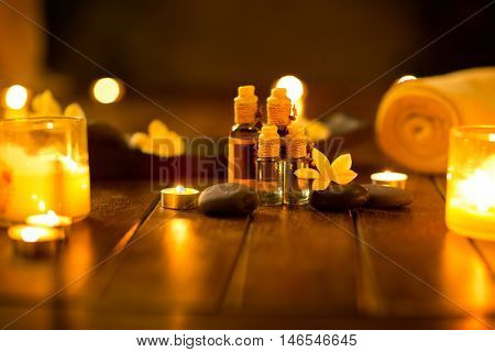 Massage oils in muffled light,  idyllic atmosphere for the massage