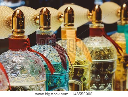 French perfume standing in a row in the store cosmetics