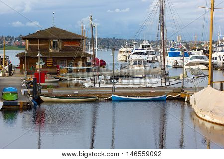 SEATTLE USA - MARCH 22: Center for Wooden Boats on Lake Union on March 22, 2016 in Seattle, WA, USA. Panorama of the lake with private yachts and boats at cloudy sunset.