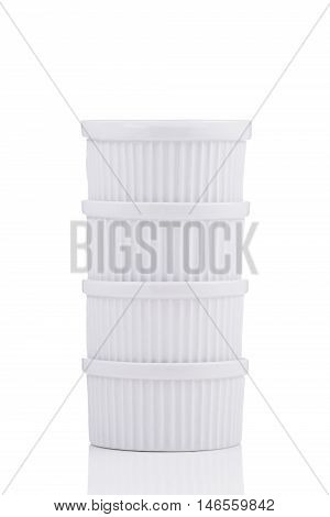 White ramekin dishes stable stack isolated on white background