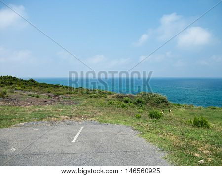 View of Desolated dead end Road Near the Sea
