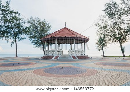 Thai pavilion on the colorful cement block near sea at Samilar beach in Songkhla Thailand