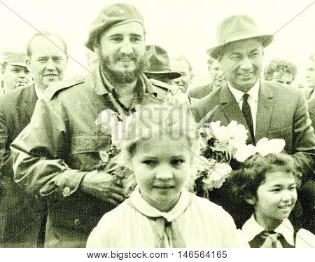 Yangiyer Uzbekistan - May 11 1963: Castro and Rashidov with pioneer girls.