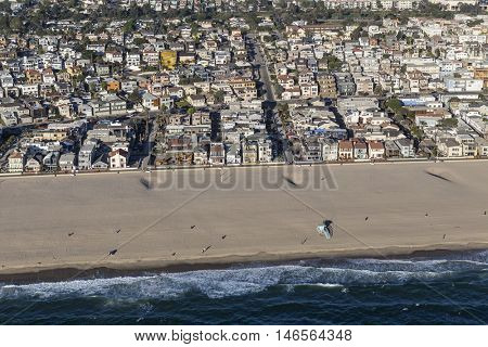 Afternoon aerial view of Hermosa Beach ocean front residential district in Southern California.