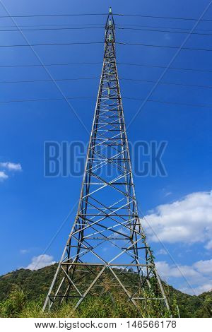 The Power transmission lines against blue sky outdoor.