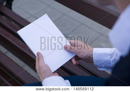 Mockup cover magazine, catalog, book. Man reading a blank magazine, catalog, book.