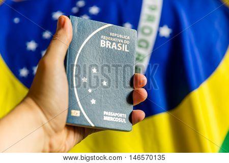 Brazilian Passport on yellow tshirt