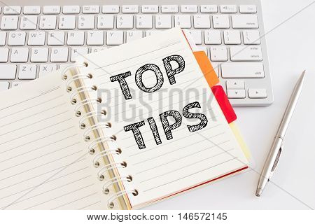 Word text Top tips on white paper on office table / business concept