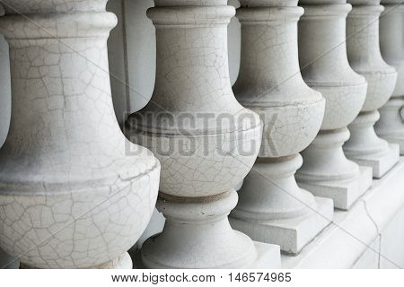 Close up of outdoor white glazed balustrade or columns