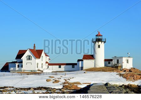 Eastern Point Lighthouse in winter, Cape Ann, northeastern Massachusetts, USA. This historic lighthouse was built in 1832 on the Gloucester Harbor entrance.