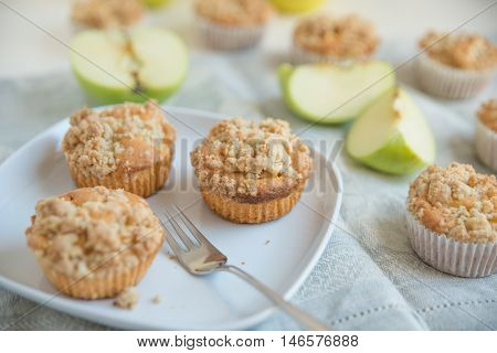 home made apple streusel muffins on a plate