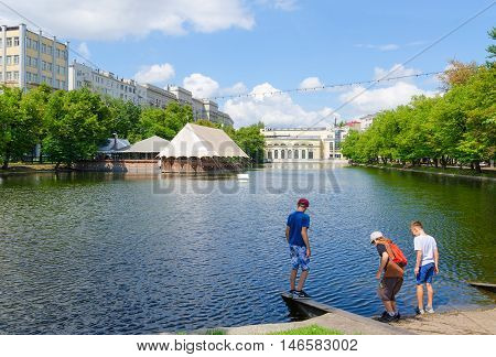 MOSCOW RUSSIA - JULY 23 2016: Unidentified teenagers relax at Chistye Prudy which are popular recreation area in city center Moscow Russia